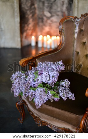 Lilac on the brown chair  - stock photo