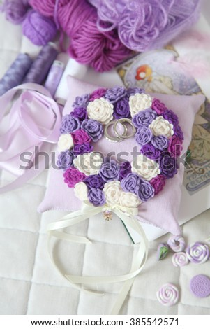 Lilac Wedding Ring Pillows. Wedding cushion for rings in the form of a wreath of flowers.   - stock photo