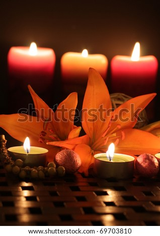 Lilies by candlelight. - stock photo