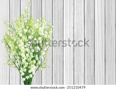 lilies of the valley flowers on color wooden planks background - stock photo