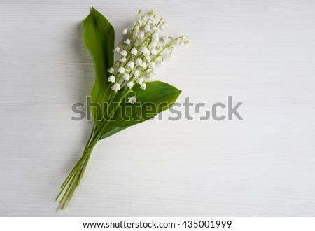 lilies of the valley on a white table