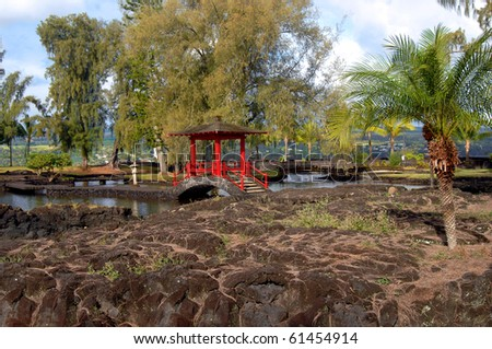 liliuokalani Gardens in Hilo, Hawaii is the largest Edo Style Garden outside of Japan.   Attractive red pagoda pavilion connects several pools inside garden. - stock photo