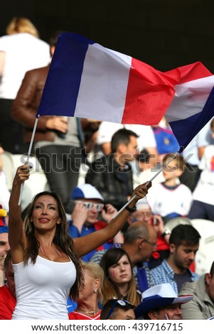 LILLE - FRANCE,  JUNE 2016 : Supporters and fans during football match  of Euro 2016  in France between  Switzerland and France at the  Stade Pierre Mauroy  on June 17, 2016 in Lille.