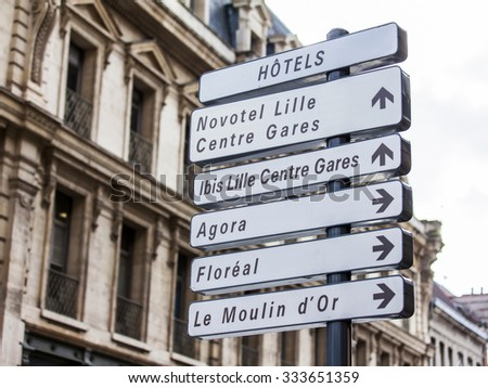LILLE, FRANCE, on AUGUST 28, 2015. Elements of city navigation. A direction sign to sights