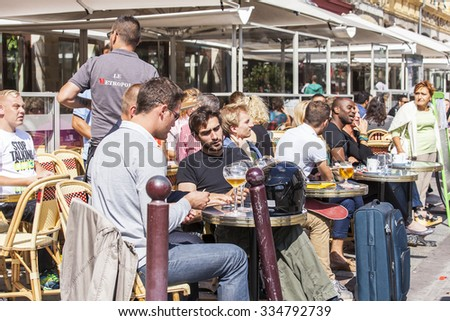 LILLE, FRANCE, on AUGUST 28, 2015. Picturesque summer cafe on the street. People eat and have a rest
