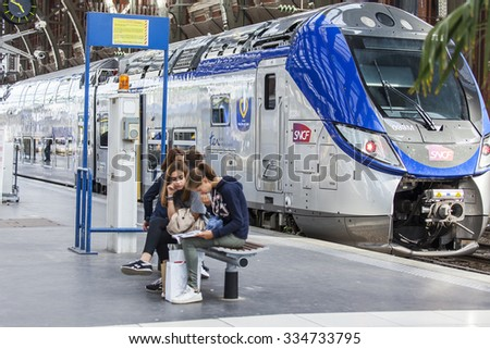 LILLE, FRANCE, on AUGUST 28, 2015. Platforms of the railway station. Trains and passengers. - stock photo