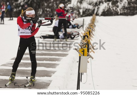 LILLEHAMMER, NORWAY – JANUARY 28: Woman firing rifle during the Statkraft biathlon tournament organized by the Norwegian Biathlon Association on January 28, 2012 in Lillehammer, Norway.