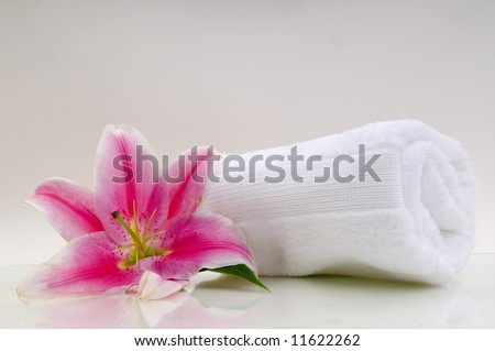 Lilly flower with white towel - stock photo