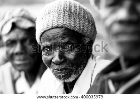 LILONGWE - MALAWI - JULY 30, 2015: Unidentified old Malawian man with hat on July 30, 2015 in a village near Lilongwe, Malawi - stock photo