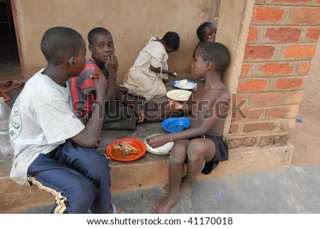 LILONGWE, MALAWI - MAY 30: Children eat at the Chisom orphanage in Lilongwe, Malawi on May 30, 2008. - stock photo