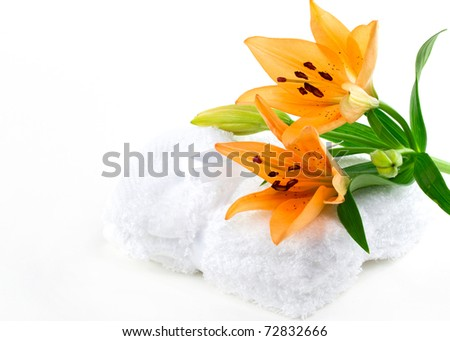 Lily flowers on white towels