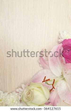 Lily flowers on wooden background with copy space, valentines day background