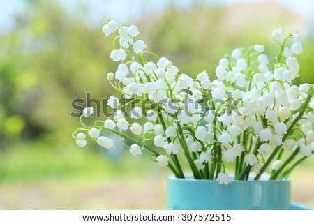 Lily of the Valley in cup, outdoors - stock photo