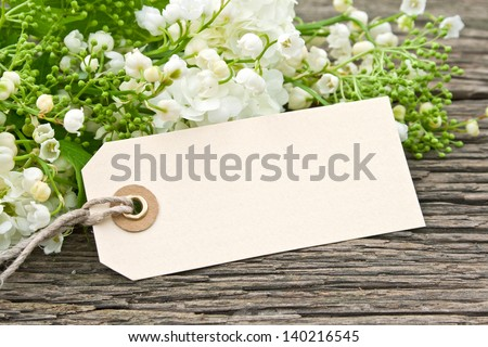 lily of the valley, snowball and label/may/spring - stock photo