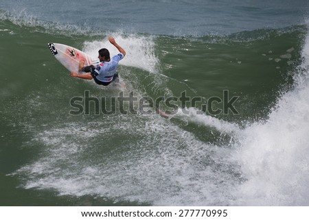 LIMA - PERU CIRCA 2015: Instant of a unidentified surfer while rides a wave in Punta Hermosa beach circa 2015 in Lima. Punta Hermosa beach is an important surf place closer of Lima city.