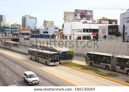 LIMA, PERU - FEBRUARY 13, 2012: Metropolitano bus Line A at Avenue Ricardo Palma in Miraflores on February 13, 2012 in Lima, Peru. The Metropolitano is a Bus rapid transit system operating since 2010. - stock photo
