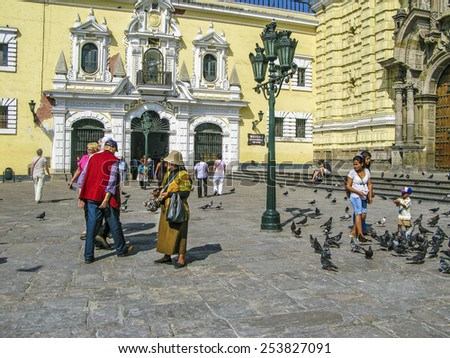 LIMA, PERU - JAN 15, 2015:  woman dressed with traditional clothing sells handcraft in front of San Francisco church in Lima, Peru. - stock photo
