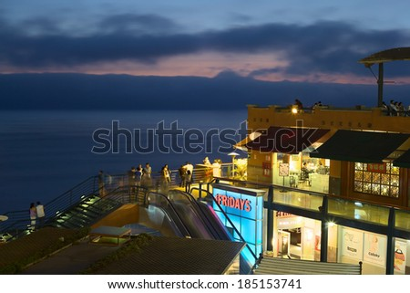 LIMA, PERU - MARCH 11, 2012: Unidentified people in the shopping mall Larcomar in the evening on March 11, 2012 in Miraflores, Lima, Peru. Larcomar is a popular mall on the coast with a nice view - stock photo