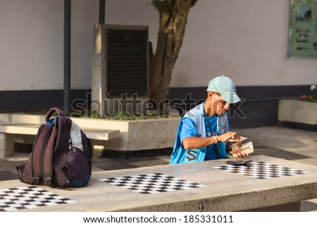 LIMA, PERU - MARCH 5, 2012: Unidentified street money exchanger counting Peruvian soles bills at outdoor table in Miraflores on March 5, 2012 in Lima, Peru. Mobile money exchangers are common in Lima - stock photo