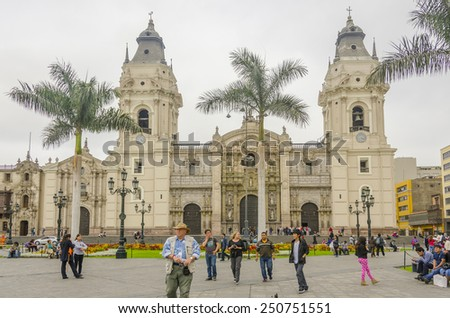 LIMA, PERU, MAY 23, 2014: Plaza Mayor with Cathedral de Lima in background  - stock photo