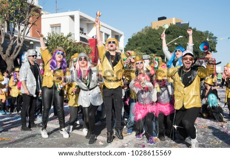 Limassol, Cyprus - February 18 2018: Happy team of people dressed in colourful costumes enjoying the famous carnival parade in Limassol city, Cyprus