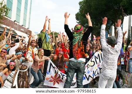 LIMASSOL, CYPRUS - MARCH 6: Unidentified participants  in hippie costumes in Cyprus carnival parade on March 6, 2011 in Limassol, Cyprus, established in 16th century, influenced by Venetian traditions - stock photo