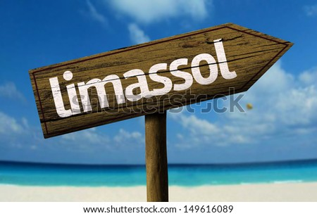 Limassol wooden sign with a beach on background - stock photo