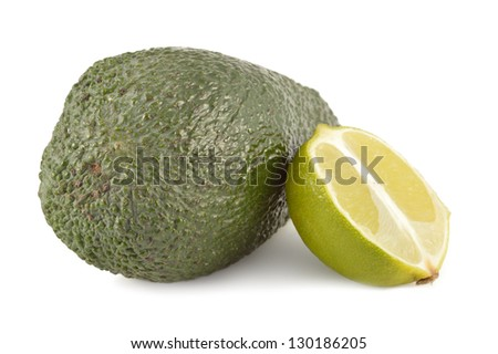 Lime and avocado on a white background close-up - stock photo