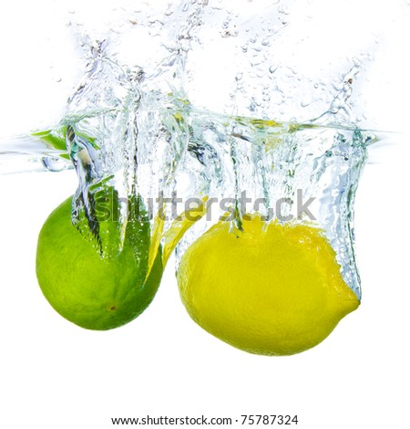 lime and lemon splashing water isolated on white background - stock photo