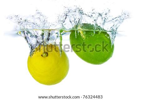 lime and lemon splashing water isolated on white background - stock photo