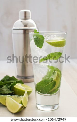 Lime and mint drink with shaker - stock photo