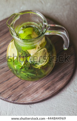 Lime and mint lemonade on a wooden rustic board