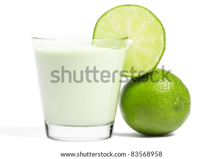 lime blade on a milkshake and lime aside on white background - stock photo