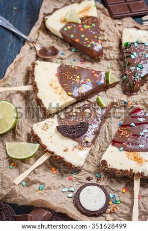 Lime Cheesecake on chocolate basis. Lime ice-cream cake with chocolate. Christmas dessert.  - stock photo