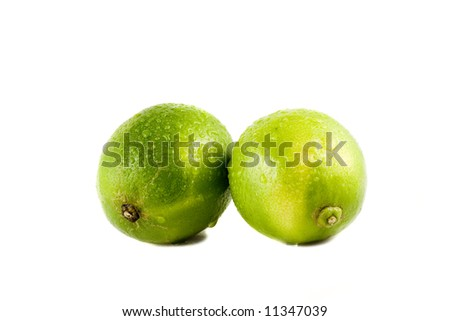 Lime fruits with water drops isolated on white background - stock photo