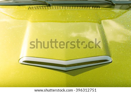 lime green glitter covered vehicle hood abstract - stock photo