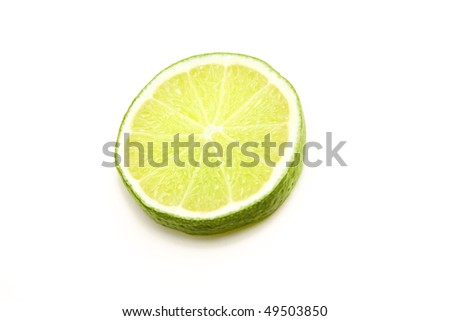 lime in sclices on a white background - stock photo