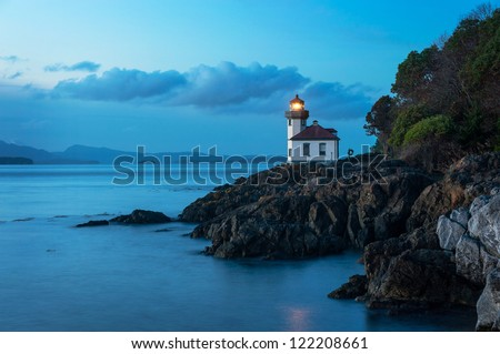 Lime Kiln Lighthouse located on San Juan Island in the Puget Sound area of western Washington State, USA. - stock photo
