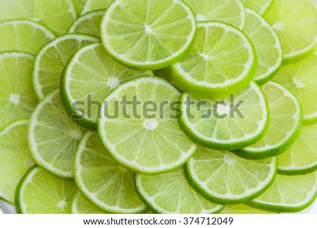 Lime slice background - stock photo