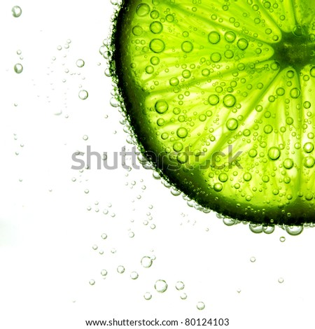 lime slice in water - stock photo