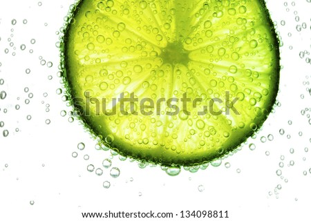 lime slice in water bubbles - stock photo