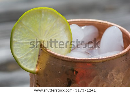 Lime slice on copper cup - stock photo