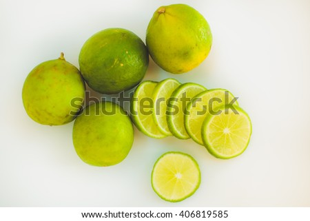 Lime slices background in green and white