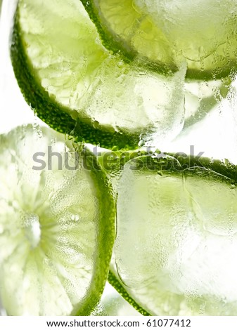 lime slices in ice macro - stock photo