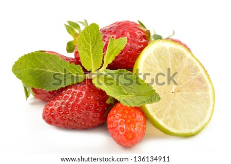 Lime, strawberry and mint leaves on a white background - stock photo