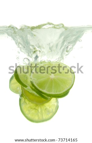 Lime thrown into the water with splash, on white background. - stock photo