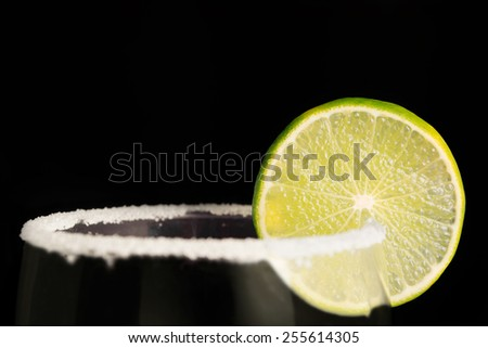 lime wheel and salt on the rim of a glass - stock photo