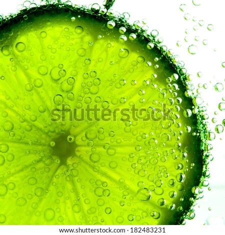lime with bubbles isolated on white - stock photo