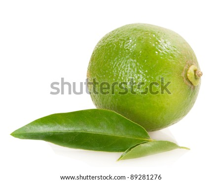 lime with green leaves isolated on white background