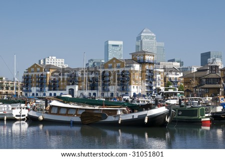 Limehouse Basin. General view of Limehouse Basin, with luxury waterside apartments and Canary Wharf`skysrapers on the background.